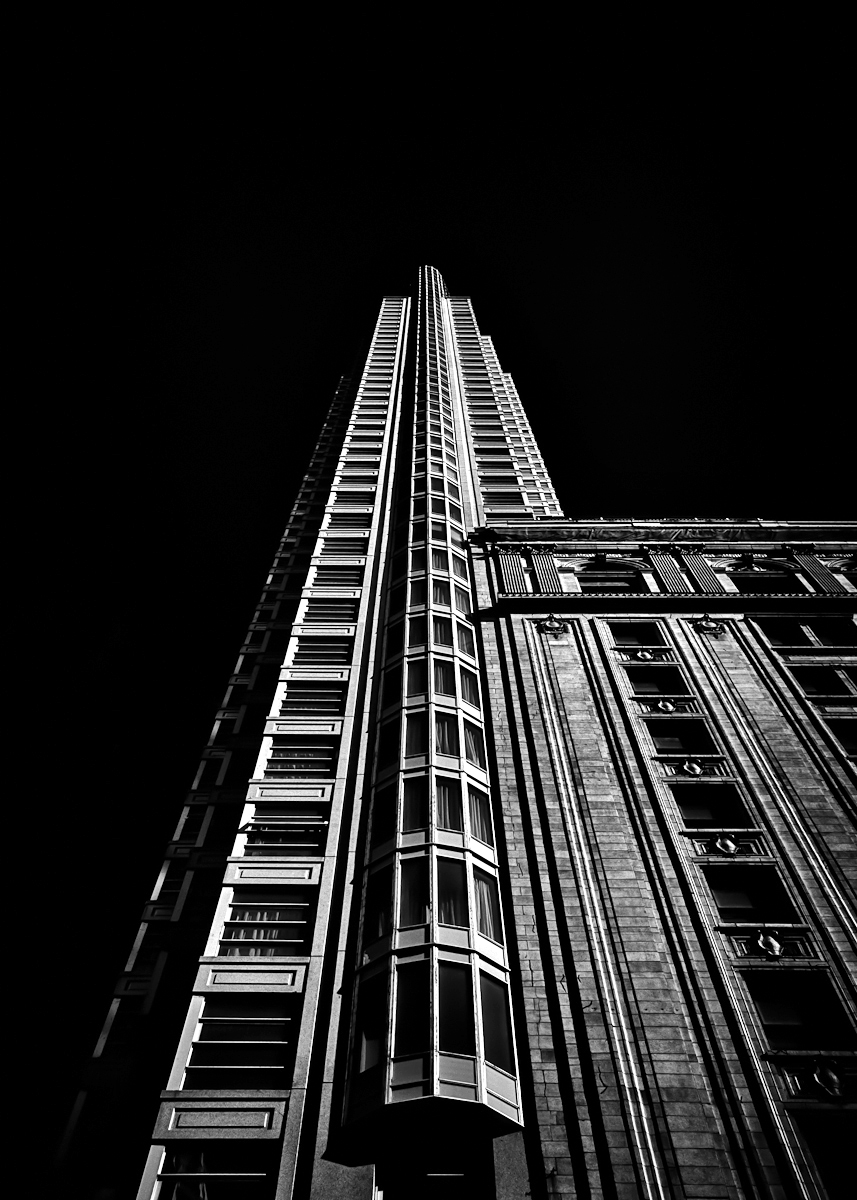 No 1 King Street West in Toronto Canada. The 51 storey condominium tower at the corner of King and Yonge Sts is the tallest residential building in Canada and has the most slender height to width ratio of in the world. Canon EOS 60D body with a Sigma 17-70mm f2.8 DC Macro OS lens. Silver EFEX Pro as a Lightroom plugin for the B&W conversion. Brian Carson The Learning Curve Photography www.thelearningcurvephotography.tumblr.com