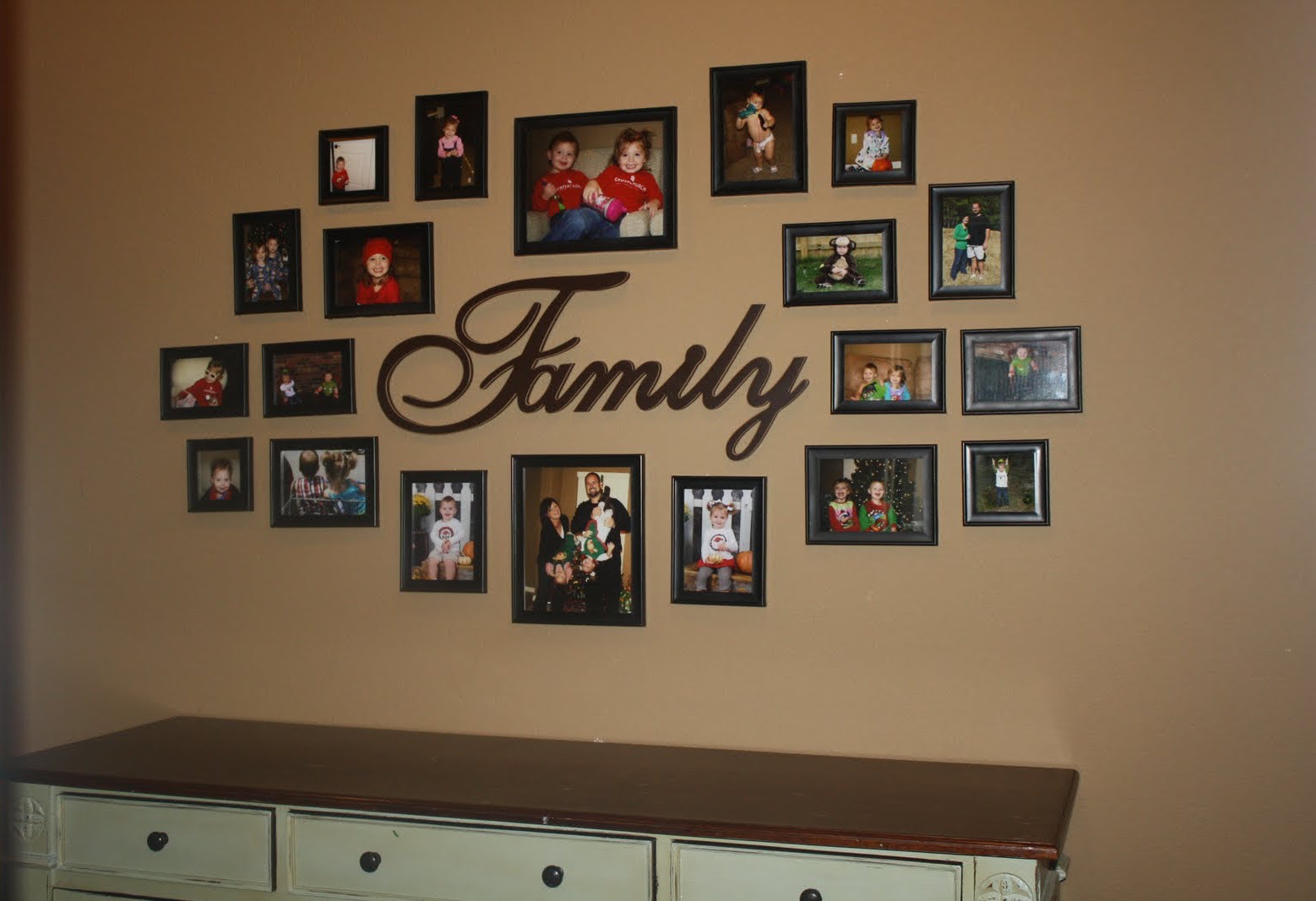 family pictures on our hall wall