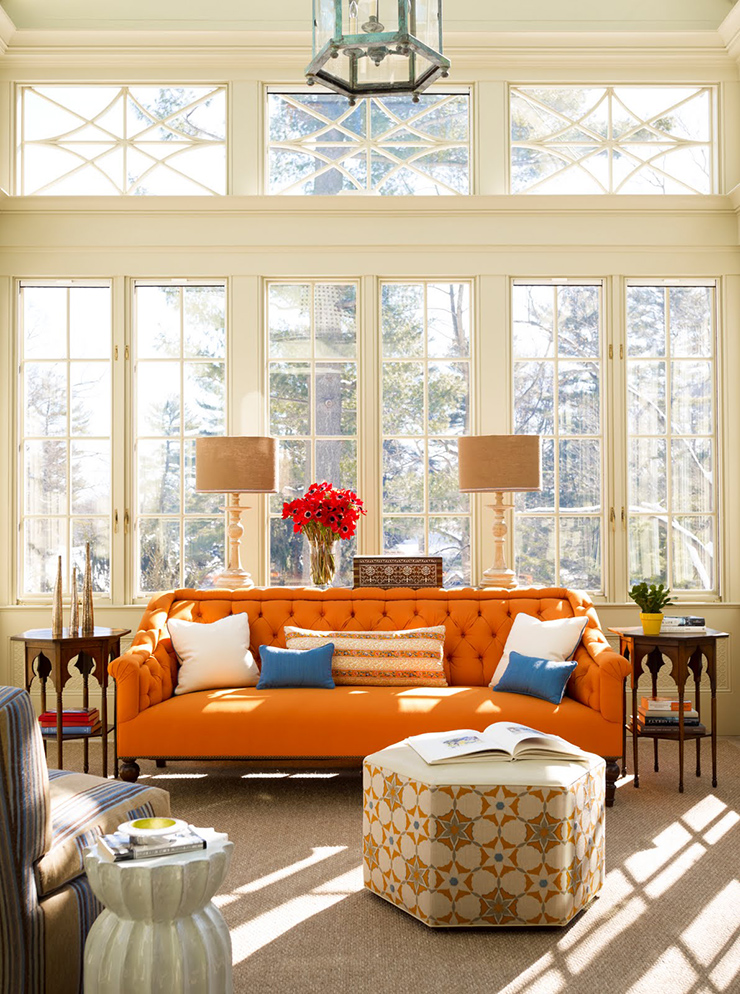 Extraordinary Orange Upholstery Sofa Plus Hexagon Ottoman Coffee Table And Asian Pendant Light For Eclectic Living Room