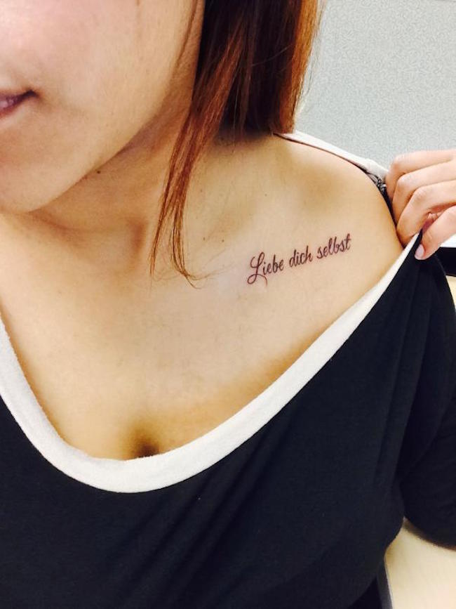 Sweet love Tattoo quote in German on collar bone
