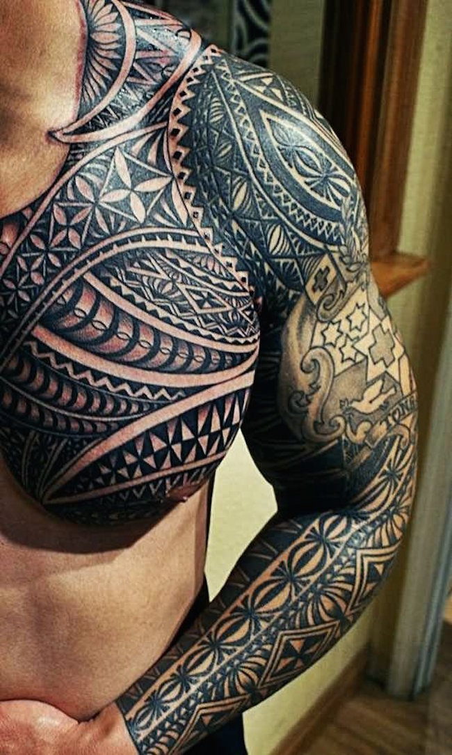 Tattoo On Man Left Sleeve And Chest