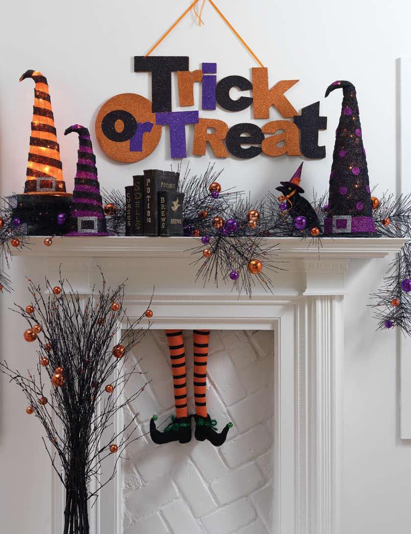 orange and purple Halloween mantel decor with witch legs