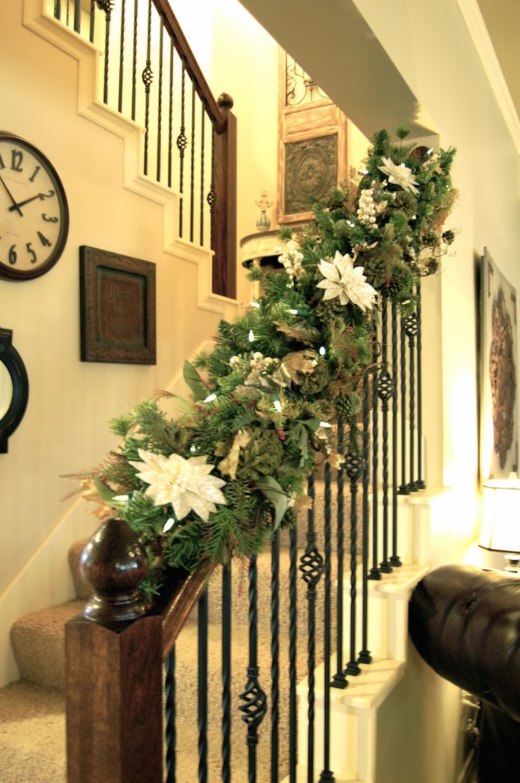 27 christmas staircase decor ideas that you will love for Stair railing decorated for christmas