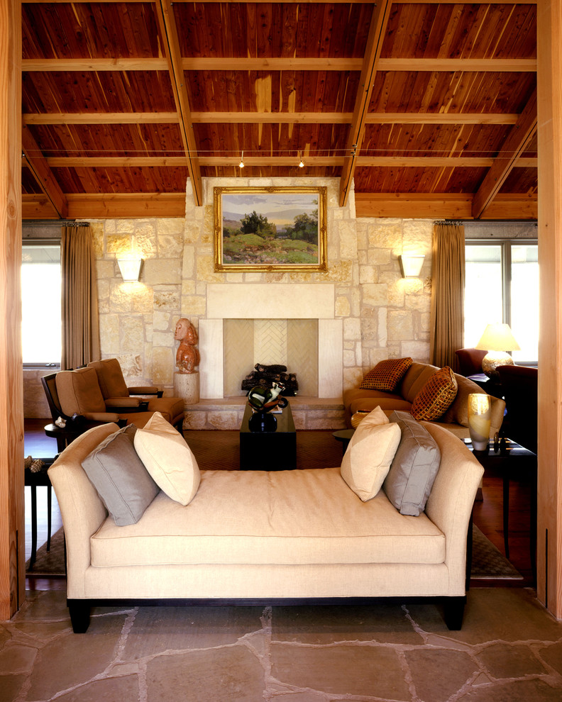 Impressive-Hemnes-Daybed-mode-Austin-Mediterranean-Living-Room-Decorating-ideas-with-artwork-day-bed-fireplace-hearth-neutral-colors-pavers-sconce-sloped-ceiling-stone-fireplace-surround